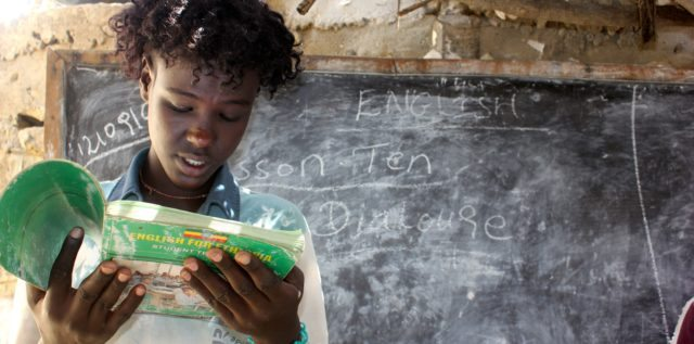 Semere reads a book in his class at Maykuho School in Northern Ethiopia.